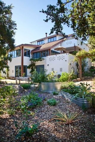 The exterior of the home, surrounded by xeriscaping and smartly thought out gardening ideas.
