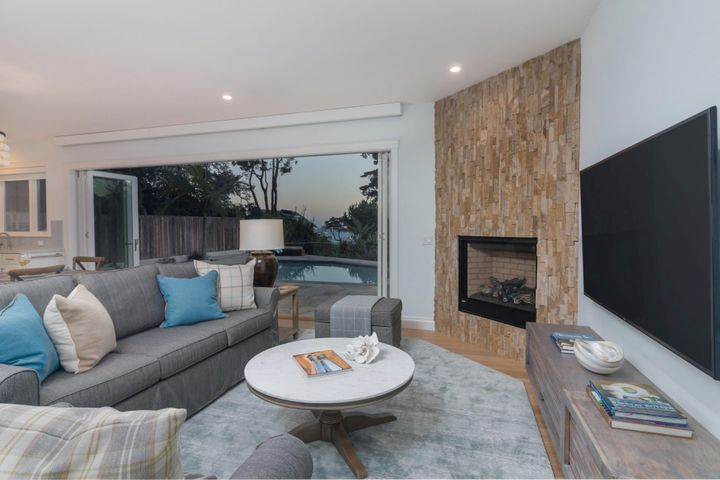 Living room with gas fireplace and views