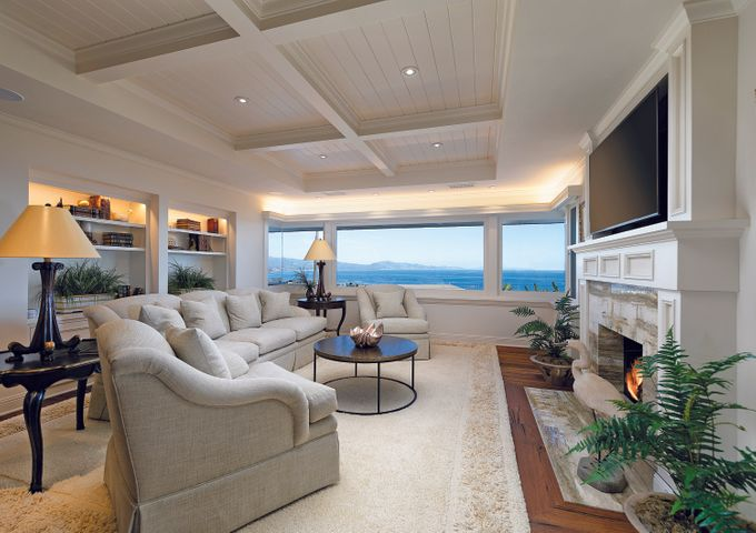 Living room with views and fireplace