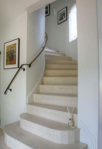 Central Staircase leads to 3 bedroom sui
