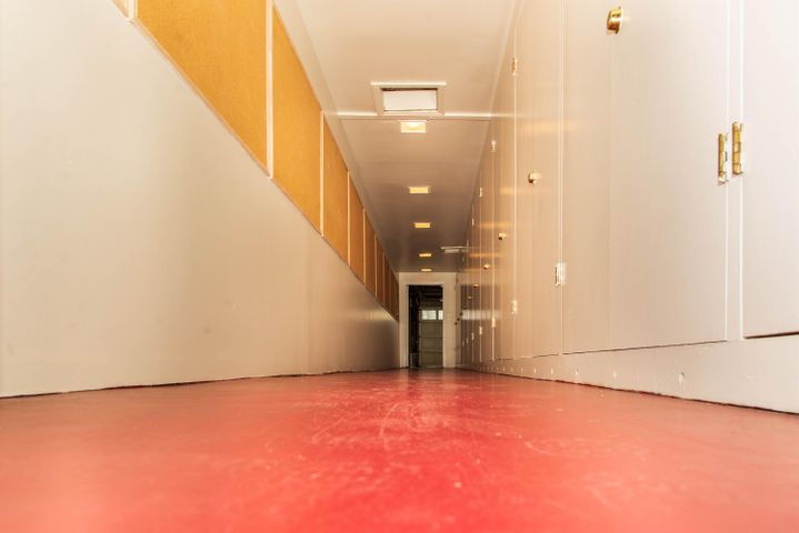 Tunnel hallway to 4 car garage