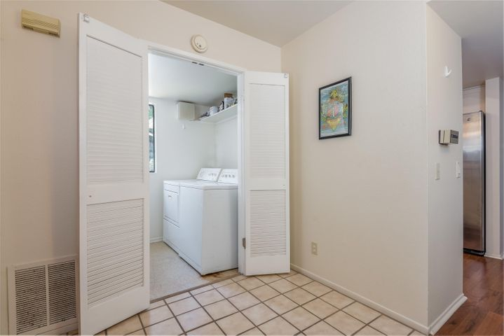 Private laundry room at entry