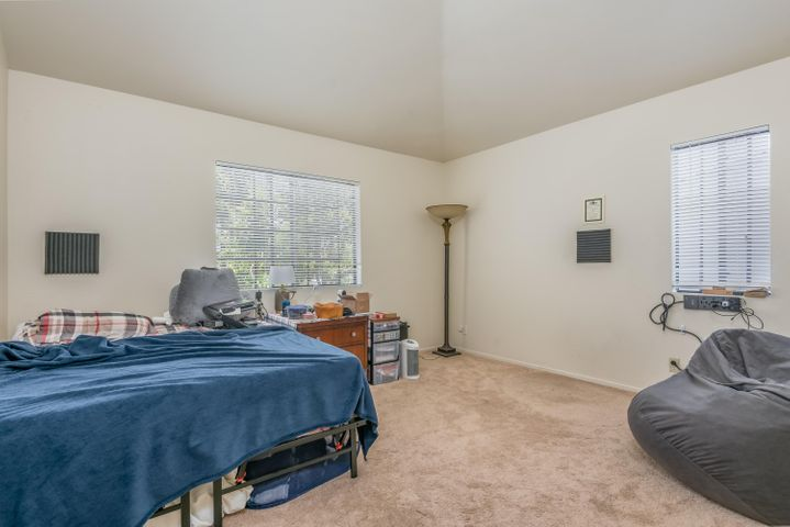 Bedroom 2 with vaulted ceiling