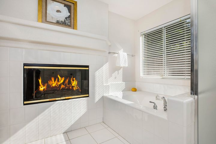 Soaking tub and fireplace