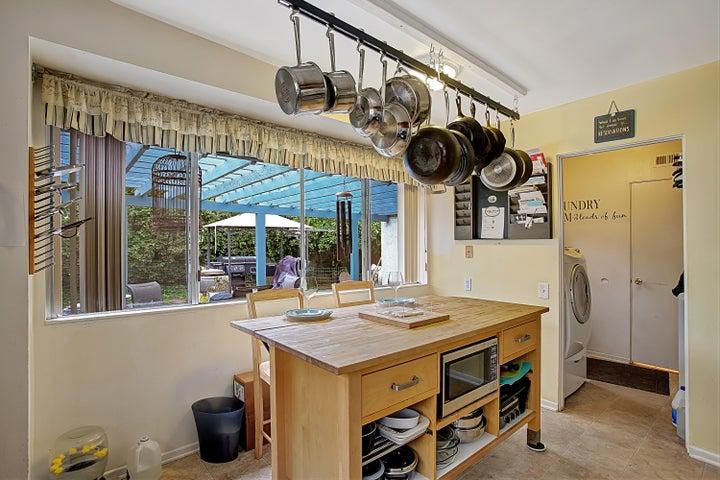 Kitchen w/ large window to backyard