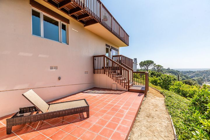 Very large, level tile patio