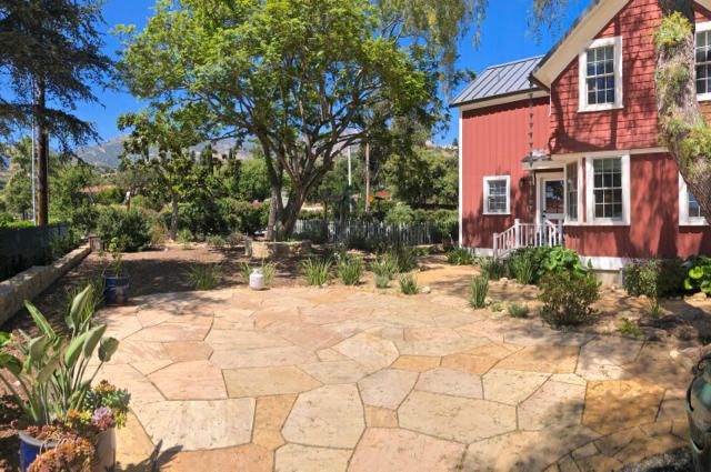 Large sideyard stone patio