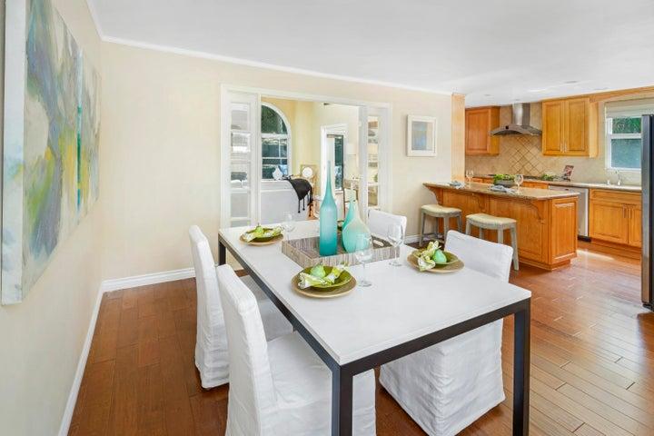 Dining room shows open floor plan
