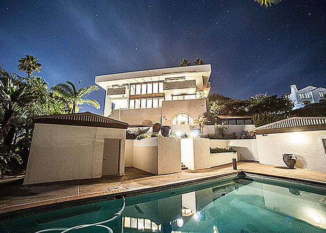 Nightime view of property from pool