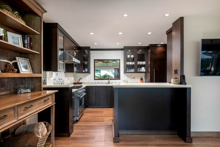 Kitchen with custom walnut cabinets