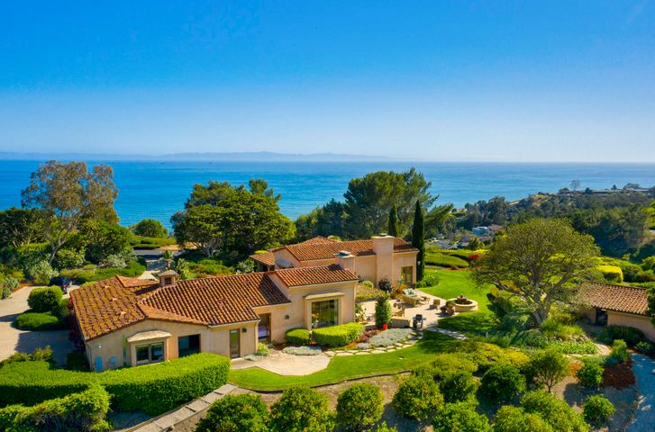 Mediterranean villa with close up ocean views on prominent ridge top.