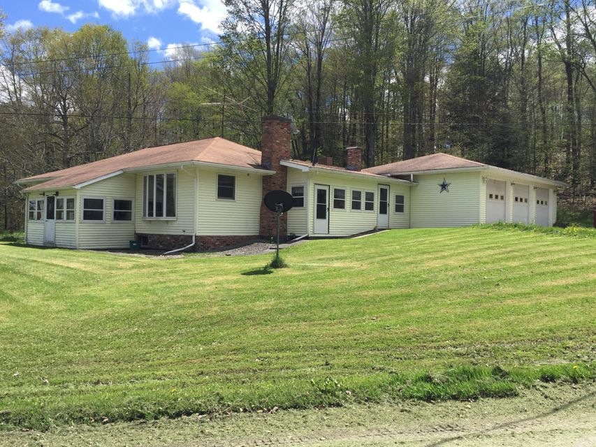 Beautiful 5 Bedroom, 3 Bath, air conditioned home outside of Montrose. House sits on over 3 acres with a heated 3 car garage, large living room, finished basement, and huge private deck. Come see this one of a kind home today!