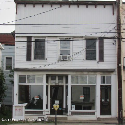 Great office space for lease.  Newly remodeled.  2 offices and bathroom.  Dry basement storage of 600 sq ft. Great location for craft shop, office. 1st floor business, great windows.  Private off road driveway parking.