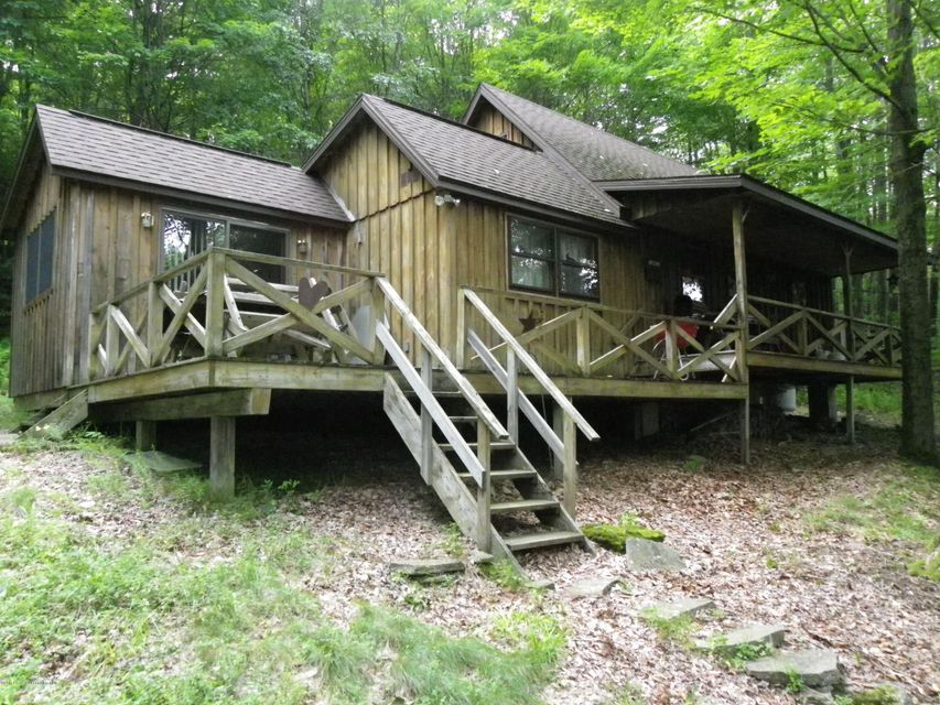Beautiful peaceful get away, close to elk mountain, nice family room, nestled in the woods. Gas rights convey to new owner.