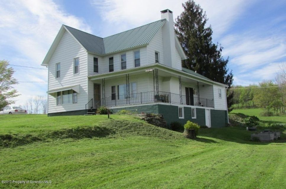 Relax with over 20 miles of beautiful views in this exquisite farmhouse with over 40 acres of enjoyment. Nice pond and landscape fields and woods what a wonderful property.