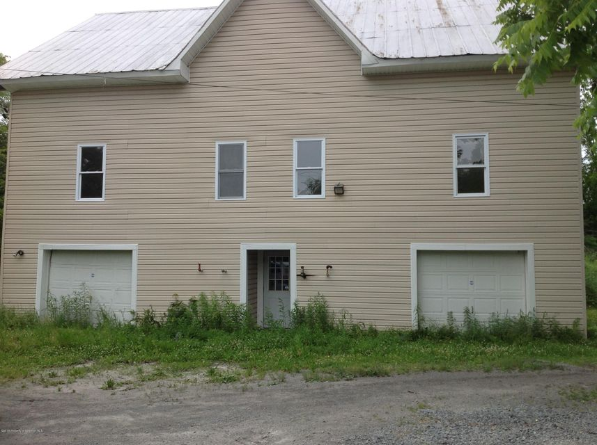 Well built structure with many improvements.  2nd floor was previously used as an office. Entry to the office is in the back with a large ramp for convenience. There is space on that floor for an apt. 2 bd/1 bath. This could be used as a 2 family also. Quiet back yard.Parcel is being sub-divided to the 2 acres.
