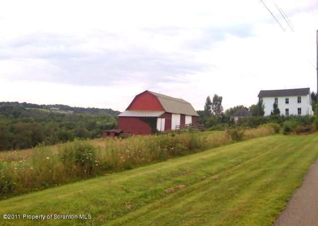 Land with barn and storage building