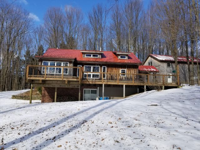 This beautiful home is one of the most unique in the town of Montrose!  Nestled on over 5.5 acres this wooded lot offers a stunning view of the Endless Mountains with a large deck across the front of the home. Patio doors adorn the family room on lower level & the master bedroom. The master has a full bath & an additional whirlpool tub, cathedral ceilings, sky lights & walk-in closet. The modern kitchen is equipped with butcher-block island, stainless steel appliances, lighted cabinets with frosty-glass cabinet doors, gas stove with range & additional wall oven. The two-bay, two-story garage includes a sizable workshop & storage on second floor.  This property location is the best of both worlds on a secluded, scenic lot & less than a mile away from downtown Montrose historic district.