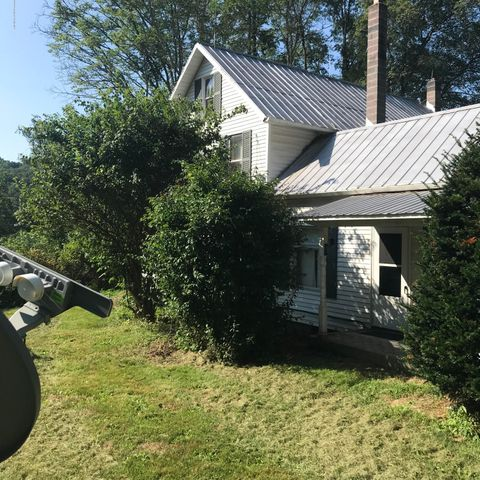 Great 3 bedroom home with enclosed and an open porch.  Great farmhouse.