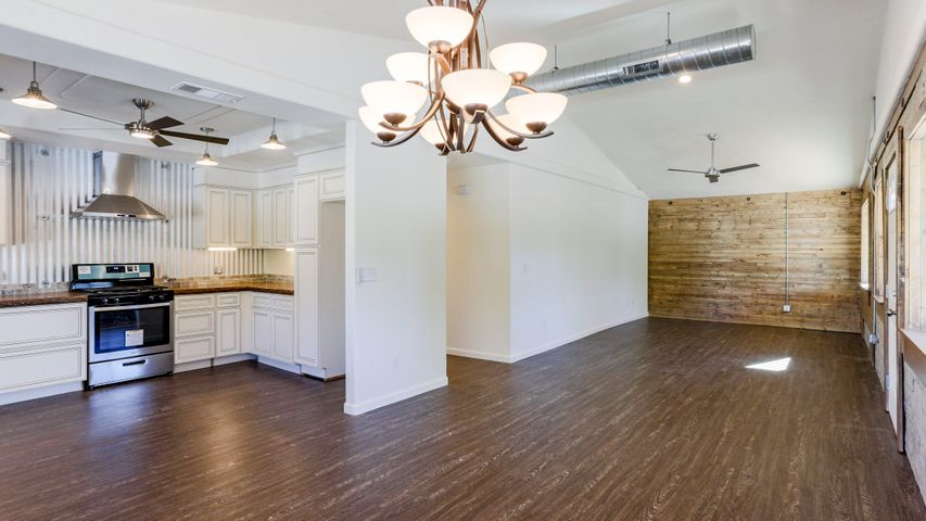 Bright and open floorplan with vaulted ceiling.