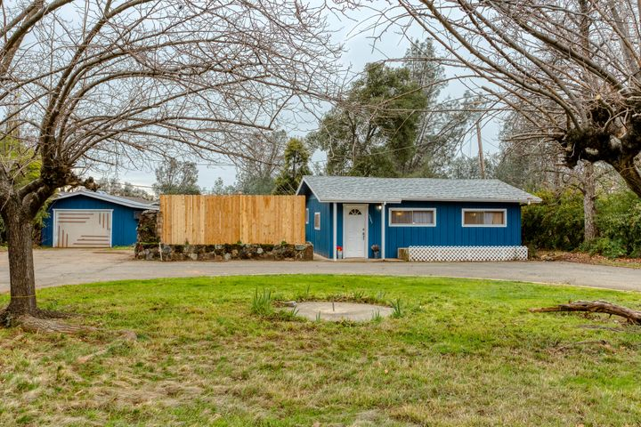 Welcome! Adorable little home set off the road with 1-car detached garage and workshop!