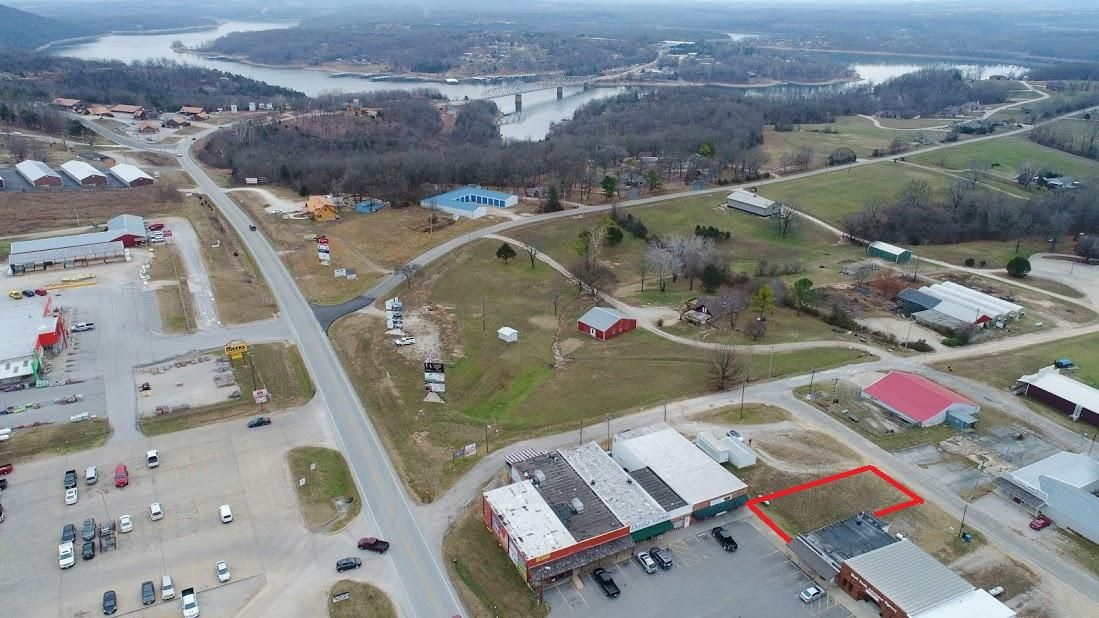 The last build-able lot in the Bridgeway Plaza in Shell Knob, MO. a great retail or office location in a Table Rock Lake Community. Shell Knob is a wonderful unincorporated community in the central part of Table Rock Lake about 45 miles to Branson, MO. and about 30 miles to Eureka Springs, AR. The lot is excellent for a building with a walkout basement and access to parking at the lower level.