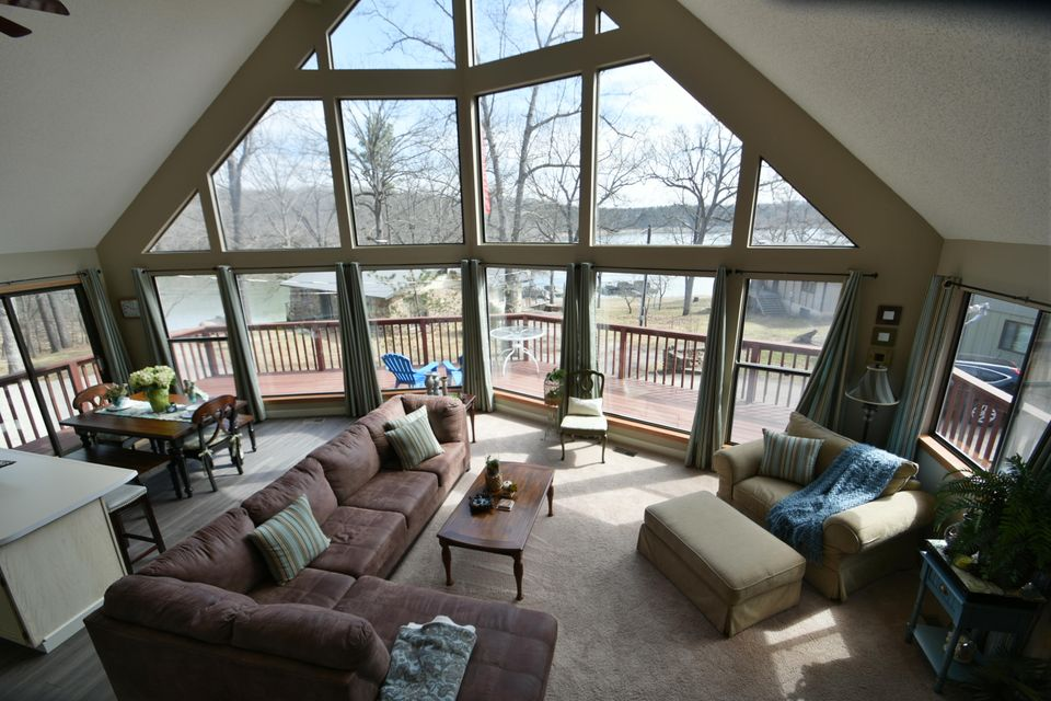 This is an Awesome Table Rock Lake Property!!! 5 Bedroom/3 full baths, 3 levels,spacious, privacy for all and Priced to Sell! This property is being sold turn-key including all furniture and is very nicely decorated and accessorized. It is located in the Golden, MO. area but is very near the Kings River Marina. The location is perfect for water sports and fishing. The property is considered lake view but is closer and has better views than many lake front properties. This is the Perfect Get-A-Way, Vacation 2nd Home. A 12 x 24 boat slip with lift is available for purchase and is just below the house.