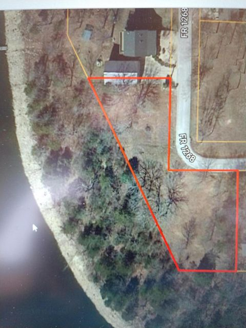 Beautiful build-able Table Rock Lake Front Lot with 245' of Red Line Zoning for a private dock. Great Shell Knob location and near Marker 21 on the lake. Septic tank and laterals are in place. 4 miles from Shell Knob shopping and restaurants. Public boat launch in the neighborhood.