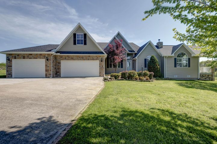 Beautiful country home offers luxurious spacious living on 2.75 acres.
