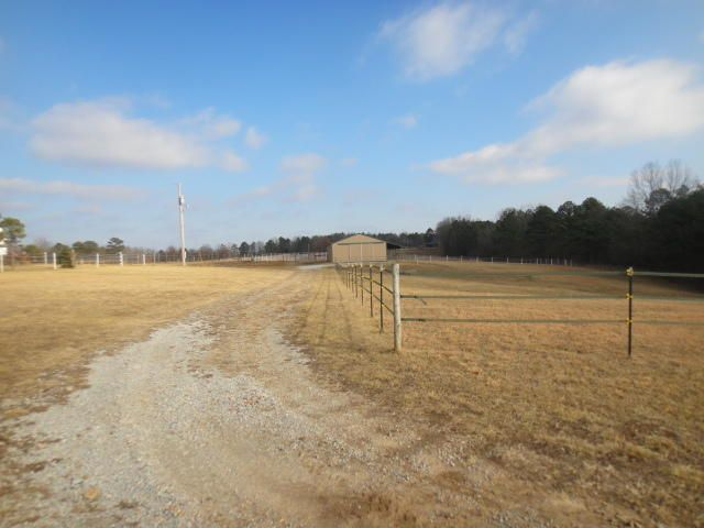 This very scenic 5 Acres M/L of land features a large 1200 sq.ft. metal barn (30x40) with a 8x40 lean-to, electric to the barn, large high double entry door (front and back) large enough for an RV, side entry door off of lean-to. Approximately 3/4 cleared in good pasture land and 1/4 in woods, good fencing and cross fencing. Property is fenced and currently ready for horses. Bring your building plans; build that new home you've always dreamed of and have that easily maintained equine ranchette! Equine community with miles of riding trails!