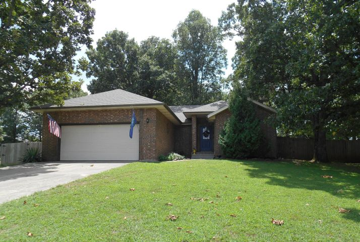 ALL BRICK ranch on large treed corner lot . . .