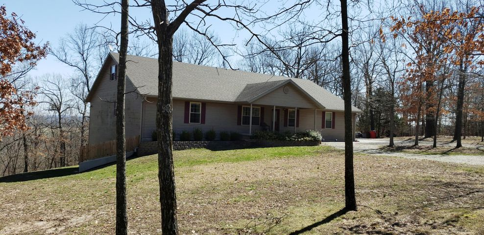 Only 4 miles North from I 44 in Strafford on state highway 125 this walkout basement home was custom built and sits in the most beautiful location with sunrise views.