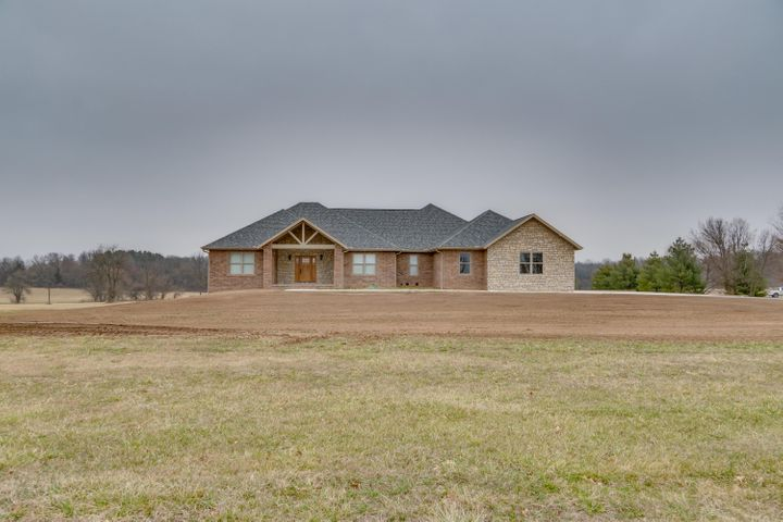 WELCOME TO THIS BRAND NEW HOME ON 10 ACRES!