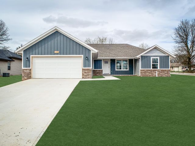 Lawn has been Photo shopped This house is similar to what is being built.