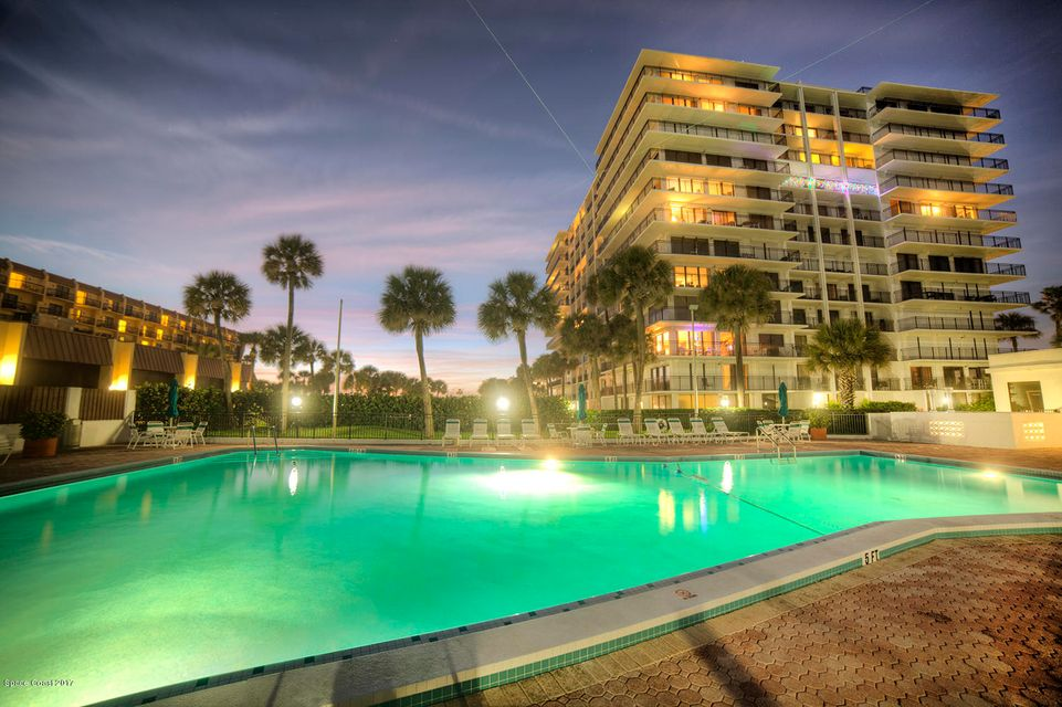 Here is a direct ocean NW corner unit that has come available! Clean 2/2 that breathless ocean views from your wrap around balcony. Watch all of the launches from Cape, see all of the cruise ships, and enjoy all the sunrises your heart can take. All of this from arguably one of the best managed buildings in world famous Cocoa Beach. On-site manager, largest community pool, private beach access, sauna, exercise room, & private 1 car garage. Bring your offer today!!