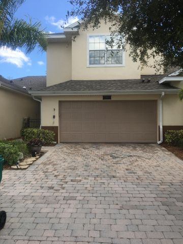 Front view with gorgeous pavered driveway and sidewalks