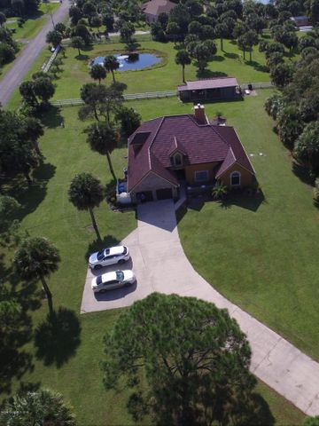 Aerial view of 2.7 acres and luxury home with swimming pool and horse barn