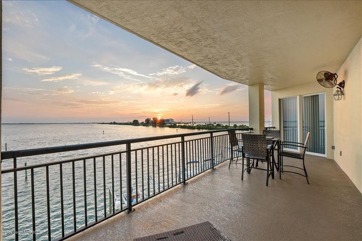 Glorious views from this 3 BR 3 BA riverfront luxury condo with boat slip & 2 car private garage