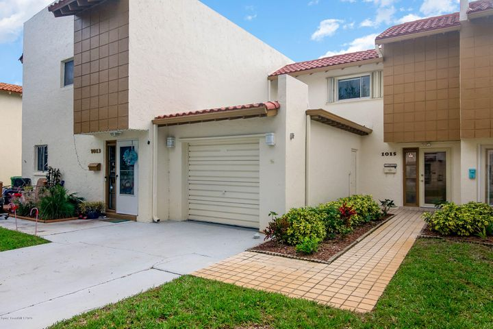 Walk to the beach from this beachside townhouse ready for your personal touch!
