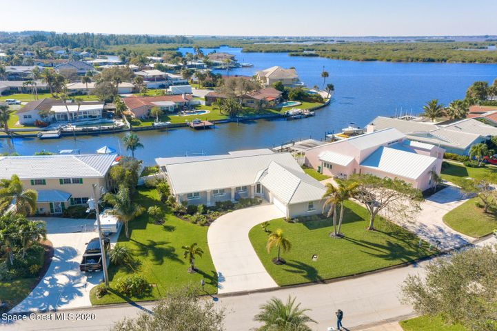 Beautifully Landscaped with a Large Curved Driveway on one of the nicest streets in Cocoa Beach