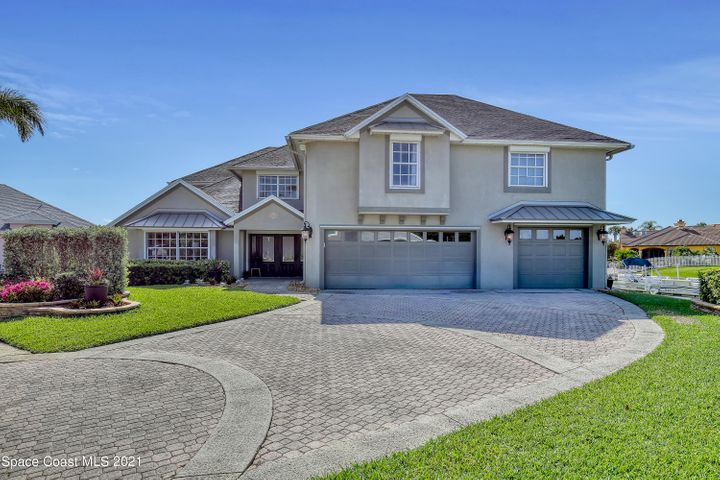 Welcome Home! This 5 Bed, 4 Bath, ~4800 sqft. luxury, waterfront property is the gem of Sykes Cove.