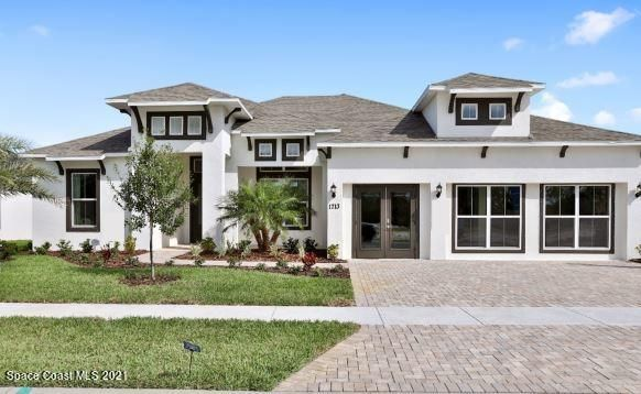 Model home with a Contemporary elevation and 3-car garage