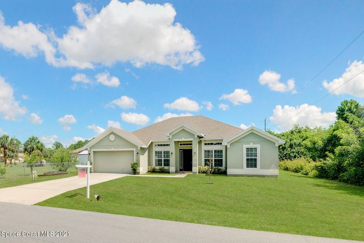 Beautifully upgraded 4 bedroom, 2 bathroom, plus den pool home conveniently located to everything