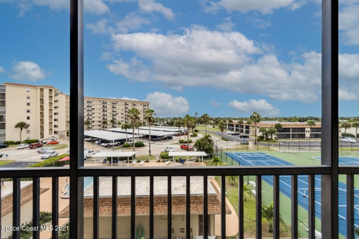 Large screened balcony with sweeping views perfect for outdoor dining and entertaining.