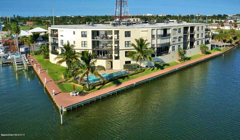 Contemporary Riverfront Condo w/ Pool, Hot Tub, Sauna, Private Lanai. Situated on a highly desirable location along the beautiful Banana River with spectacular river views this stylish residence combines comfort & sophistication w/tray ceilings, bar area, great room, and floor to ceiling impact glass doors leading out to the tranquil lanai for enjoying dolphin viewing! This beautiful home offers 3 BR, 2 BA, terrace & ample room for entertaining. Energy efficient open plan, island kitchen, high ceilings, and 8' doors. Light-filled floor plan encourages easy flow for modern living & entertaining. Private terrace w/ floor-to-ceiling windows offering sweeping views of the Banana River & a front row seat to the Annual Boat Parade. 1 car under building parking. Keyless resort style gated...