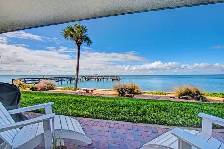 DIRECT WATERFRONT! What a VIEW!  Highly desirable, meticulously maintained building, shines pride of ownership!  You are going to LOVE this condo!  Picture yourself walking out onto your patio from your living room or master, and enjoying the most phenomenal view! Watch the manatee and dolphin play and swim right up to the seawall.  Enjoy beautiful sunsets!  The wide open water is your backyard! Lovely 3 bedroom, 2 bath, light and bright kitchen with high quality counters and cabinetry, large master with plenty of closet space, laundry room, GARAGE PARKING, ample guest parking, and workout room.  RIGHT ACROSS THE STREET FROM THE ATLANTIC OCEAN!  Great location for surfers and boaters!  Live your BEACH DREAM!  Bring your best offer, this will go quickly! Must own for 1 year before renting.