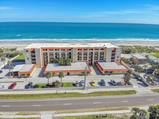 BRING AN OFFER! Direct ocean front and south corner unit condo in the quiet and residential area of south Cocoa Beach.  2 pets allowed and no weigh limit!  3 months min. rental! Plus your own private one car garage attached to the building!!  As you walk into this unit you will feel as if you were standing outside in the sand in front of this gorgeous blue ocean.  Miles of views towards the east, north and south!  Originally a 3 bedroom but 3rd bedroom converted to a family room (easy to convert back).  Tile throughout the complete apartment and kitchen updated in 2005, completely open to the dinning and living areas as well as to the west part of the condo towards the family room/3rd bedroom.  Fully furnished, all goes! Cable and wifi included in Assoc.