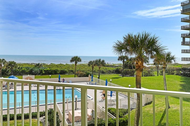 Direct ocean front living on approximately 14 acres.  Gated and guarded community. Just a few of the favorite amenities are tennis, shuffleboard, putting green, clubhouse, pool, sauna, and workout room. Direct ocean-views from almost each room in your condo on the 3rd floor. Unit features an underground deeded parking space, wet bar, laundry room under air, accordion hurricane shutters on balcony,  balcony from living room to master bedroom. Ceiling fans in each room. Master bedroom with walk-in closet and regular closet. Short distance from Port Canaveral, Orlando International Airport, Daytona Beach, Disney World. Walking distance to downtown Cocoa Beach, restaurants, library, post office, coffee cafes, surf shops, shopping, manatee watching. Top rated schools.