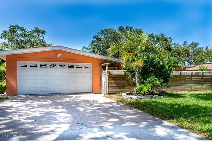 This fabulous 3/2 home in desirable neighborhood of Cocoa Isles is filled with warmth & built for lasting family memories. The beautifully renovated kitchen showcases rich cabinetry, mosaic tile backsplash, granite counters & stainless appliances, all centered around a functional island workspace. In the sunny dining area, large picture windows overlook the backyard's dazzling screened-in pool & shady lanai. And take a look at the recently updated retro-chic master bath w/its penny tile, glass shower & contemporary-vintage sink -- stunning! Add'l desirable details include a flex room for an office/ family rm, a new water heater, fresh exterior paint, a double-door storage shed, oversized laundry room w/plenty of space for your pantry, hurricane shutters, lush tropical landscaping. Just minutes from downtown Cocoa Beach and dining, this home is your personal piece of beachside bliss! Come see what the Cocoa Beach lifestyle has to offer!