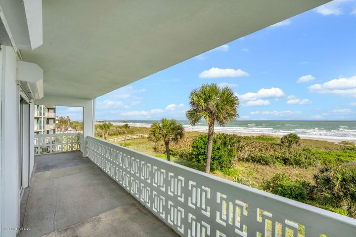 Direct ocean corner penthouse providing expansive ocean views. Wrap around terrace. This remodeled residences has the most fantastic views of the Cocoa Beach Pier and Rocket Launches! Remodeled contemporary kitchen with stainless steel appliances, undermount lighting, and ample storage. The master suite with ensuite spa bath opens to the wrap around ocean terrace. Tile flooring throughout the residence is ideal for ocean living. Plantation shutters. Guest room with privacy from the master bedroom. Remodeled guest half bath. Energy efficient tankless water heater. W/D closet. Under building parking space & storage. Desirable location by the Cocoa Beach Pier, Restaurants, & Shopping. Million dollar living without the million dollar price tag. Come experience the beach island lifestyle!